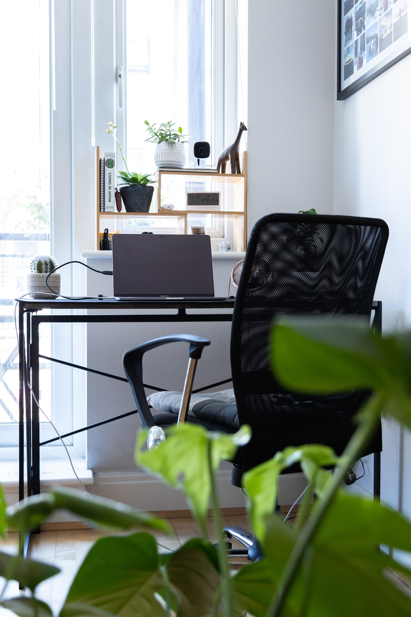 black and gray chair beside black laptop computer